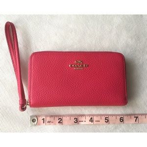 Coach wristlet with back pocket and card slots